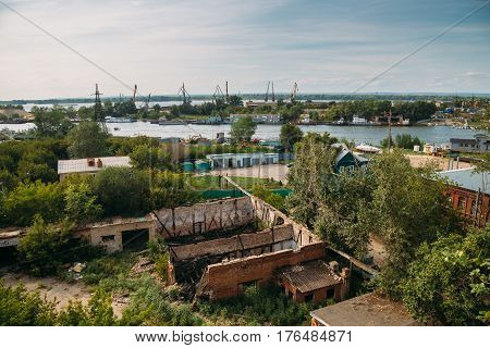 View from the roof of the industrial zone on the banks of the Volga, cranes, barges