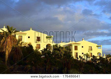 Callao Salvaje Tenerife Canary Islands Spain Europe - June 16 2016: Callao Salvaje modern apartments in Tenerife with storm clouds