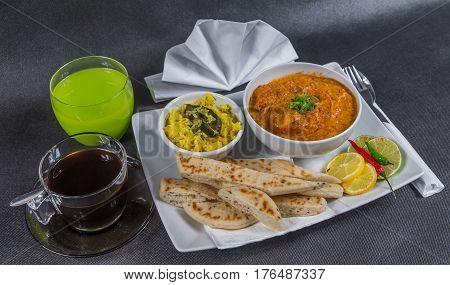 Oriental Indian Set, Chicken Tikka Masala, Naan Bread, White Plate, Black Coffee, Green Drink, Napki