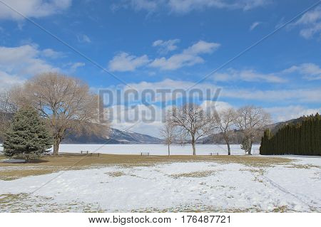 Scenic Winter Field And Lake Landscape