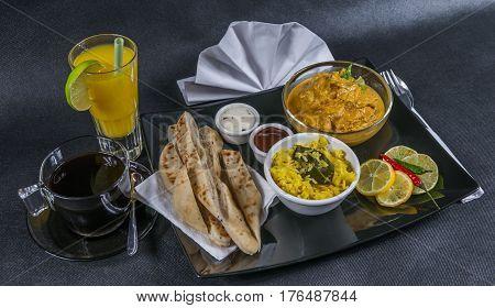 Oriental Indian Set, Chicken Korma, Naan Bread, Plate, Coffee, Orange Juice, Napkin, Peppers, Sauces