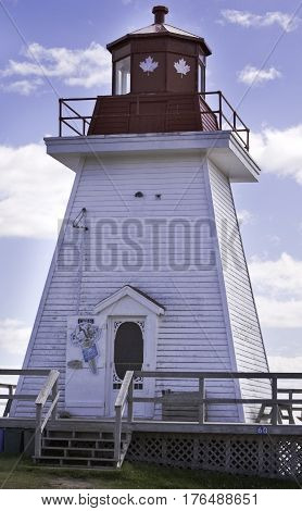 Highlands National Park, Nova Scotia, September 24, 2015 -- An old lighthouse now an ice cream shop in Cape Breton Highlands National Park, Nova Scotia on a beautiful bright cloud filled sunny day in September.