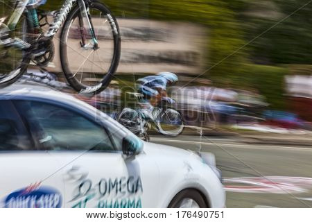 Illiers Combray France July 21st 2012: Defocused and blurred image of a technical assistance car (Omega Pharma-Quick Step Team) following its cyclist during the 19th stage- a time trial between Bonneval and Chartres- of Le Tour de France 2012.