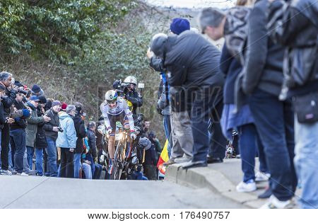 Conflans-Sainte-HonorineFrance-March 62016: The South African cyclist Daryl Impey of Orica-GreenEDGE Team riding during the prologue stage of Paris-Nice 2016.
