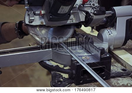 Circular saw. Work with circular saw for metal corner.