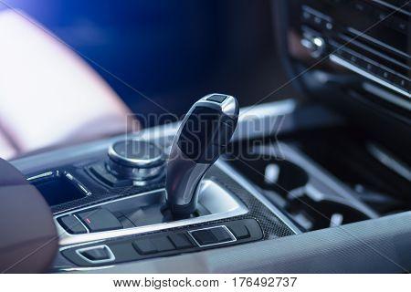 Closeup a manual shift of modern car gear shifter