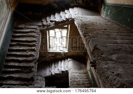 Ruined stairs and window inside old abandoned house, Odessa,Ukraine,Europe