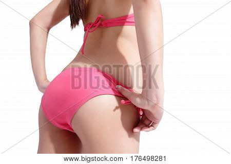 beauty woman wear bikini and show butt with isolated white background; asian