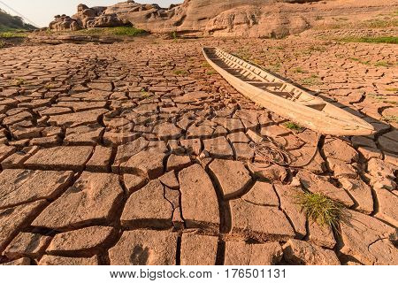 arid soil with old boat in summer season
