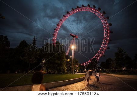 London eye in London England with orange pathway and red and blue