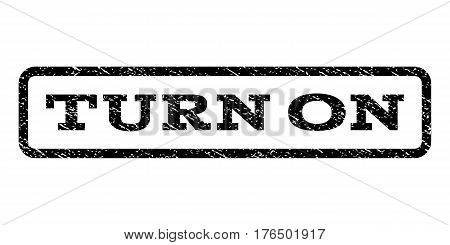 Turn On watermark stamp. Text caption inside rounded rectangle frame with grunge design style. Rubber seal stamp with scratched texture. Vector black ink imprint on a white background.