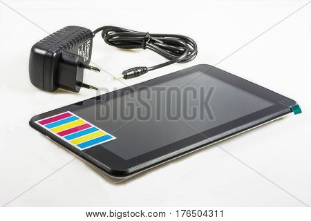 A small tablet computer on a white background