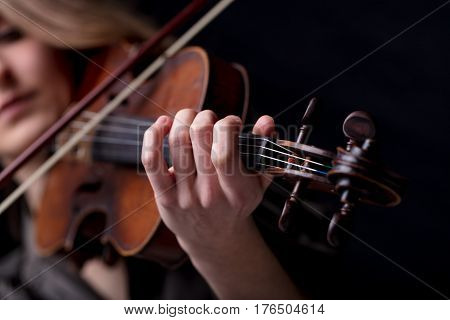 Closeup Of A Violinist's Hand Playing
