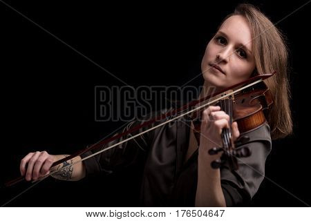 Tattooed Violinist Woman Playing In Black Background