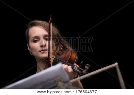 Violinist Reading Music Score And Playing