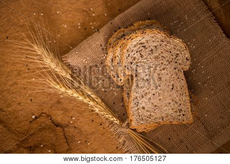 sliced whole wheat bread on dark background