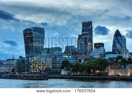 LONDON, ENGLAND - JUNE 15 2016: Sunset Skyline of London From Tower Bridge, England, United Kingdom