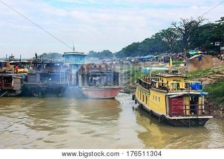 Barges anchored at Ayeyarwady river port in Mandalay Myanmar. Ayeyarwady river is the largest river in Myanmar.