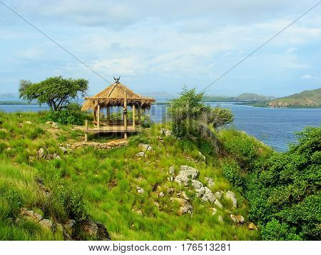 Small Hut On A Hill At Kanawa Island In Flores Sea, Nusa Tenggara, Indonesia
