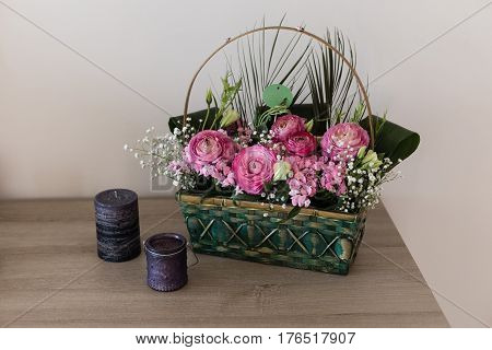 Flower Arrangement In Basket With Ranunculus And Small Pink And