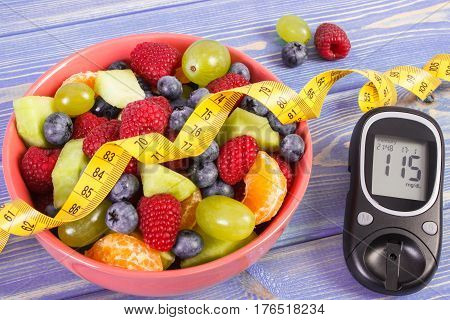 Fresh Fruit Salad, Glucometer And Centimeter, Diabetes, Healthy Lifestyle And Nutrition Concept