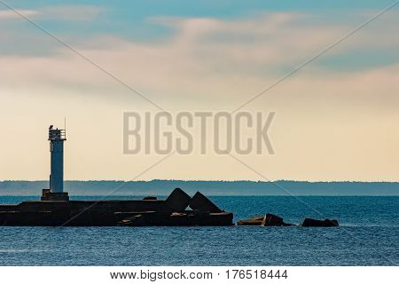 Breakwater dam with a lighthouse in the morning