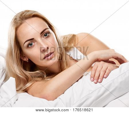 Portrait of pretty young woman awaking after sleep