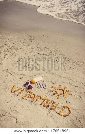 Vintage Photo, Medical Pills, Inscription Vitamin D And Accessories For Sunbathing On Sand At Beach