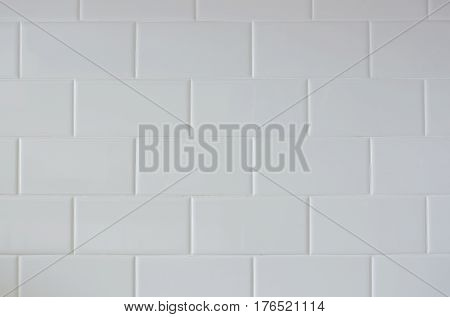 A white subway tile wall pattern indoor.