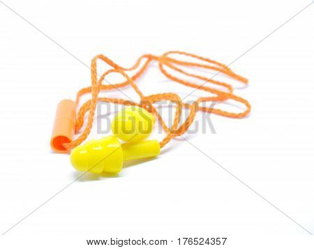 Close-up Orange Ear Plugs On White Background.