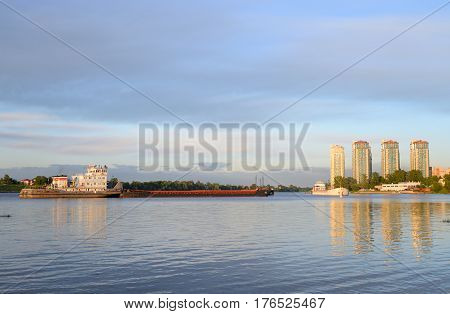River cargo ship on the river Neva on the outskirts of St. Petersburg Russia.
