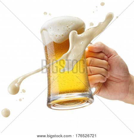 hand holding a mug of beer toasting