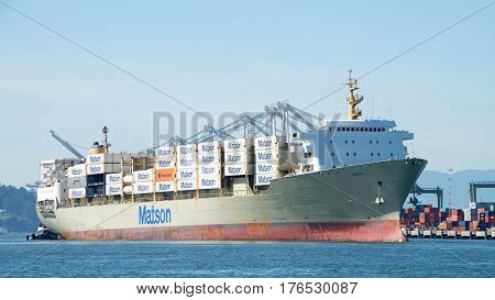 Oakland CA - March 14 2017: Matson cargo ship KAUAI entering the Port of Oakland. Matson provides shipping services Pacific wide. Mainly to and from the Hawaiian Islands.