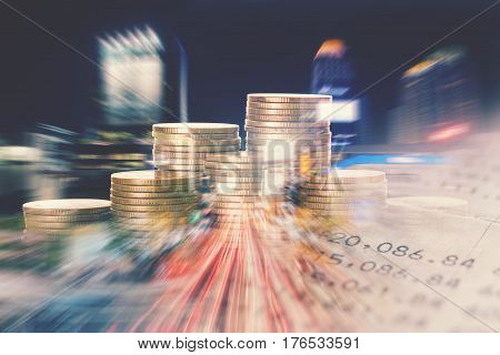 pile of gold coins with bank account and city at night background finance and banking concept
