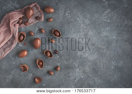 Chocolate easter eggs on dark background. Easter concept. Flat lay top view