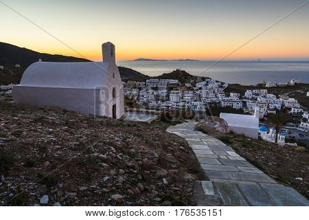 Morning view of Chora on Ios island with Santorini in the distance, Greece.
