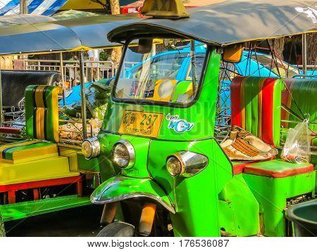 BANGKOK THAILAND - JANUARY 18 2014: Motor-taxi tuk-tuk on the street of Bangkok, Thailand