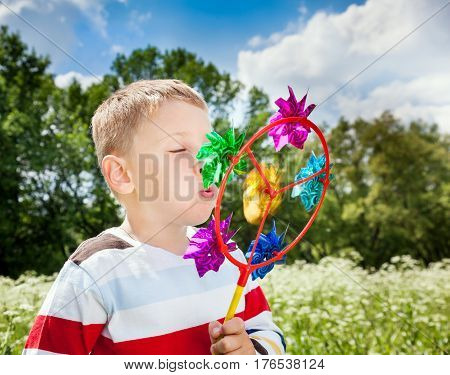 Young Boy With Toy In Hands