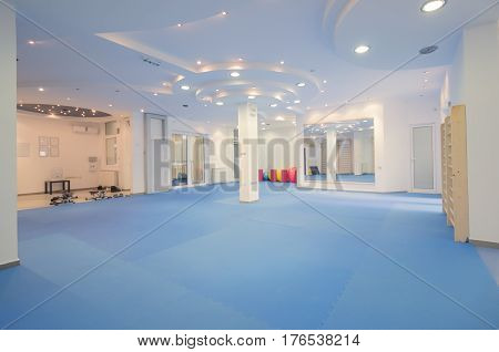 interior large room no people fitness gym physical therapy equipment