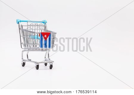 Shopping trolley with Cuban flag. Empty shopping trolley as a symbol of the financial crisis in Cuba