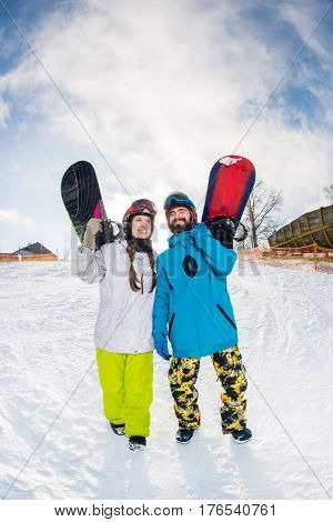 Man And Woman With Snowboards