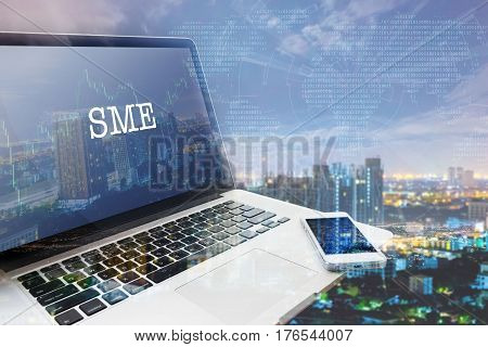 SMEs (SMALL AND MEDIUM-SIZED ENTERPRISES): Grey computer monitor screen. Digital Business and Technology Concept. Double Exposure Effects.