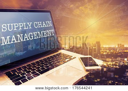 SCM (SUPPLY CHAIN MANAGEMENT): Grey screen laptop computer. Vintage effects. Digital Business and Technology Concept.