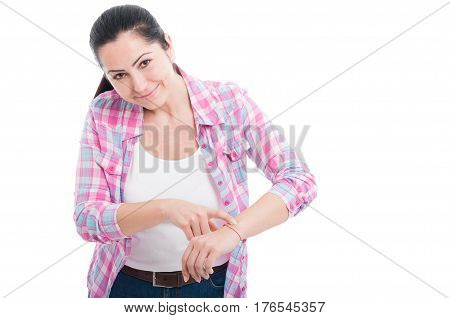 Pretty Young Female Pointing Her Wristwatch