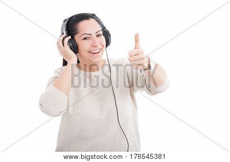 Attractive Female Listening Music On Earphones