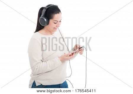 Young Woman Listening Music With Headphone