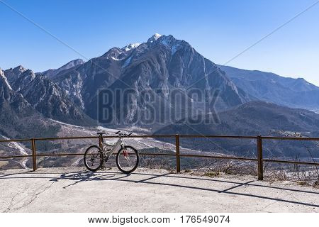 Mountainbike on Monte San Simeone with Monte Chiampon in the backround
