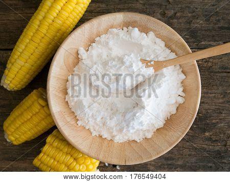 Corn Flour In Spoon On Wooden.