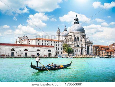 Gondola on Canal Grande with Basilica di Santa Maria della Salute in the background Venice Italy