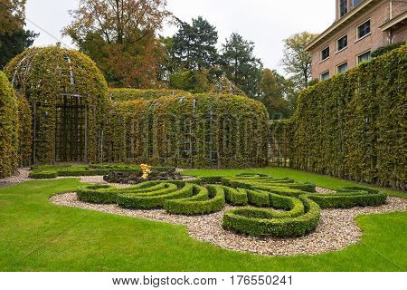 APELDOORN, GELDERLAND/ THE NETHERLANDS - OCTOBER 22, 2016: Garden corner with berceau at the Palace Het Loo